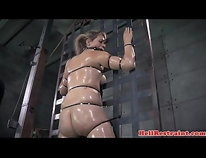 Oiled slut bonded and caned in front NT