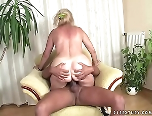 Busty grown up lady and a ebon cock