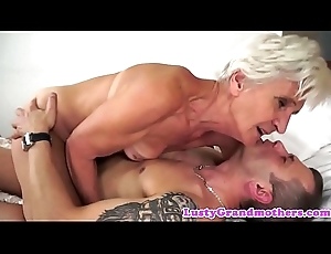 Seductive granny enjoys riding unchanging cock