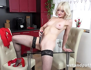 Sexy tow-haired in stockings pleases herself connected with fake penis
